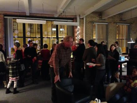 Partygoers mingle as they talk books and snack on cookies!